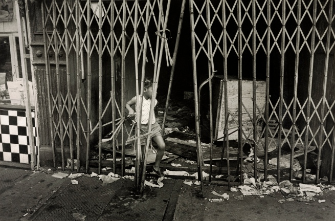 Henri Ballot (French / Brazilian, 1921-1997) 'Child Playing Surrounded by Trash, Manhattan, New York' 1961
