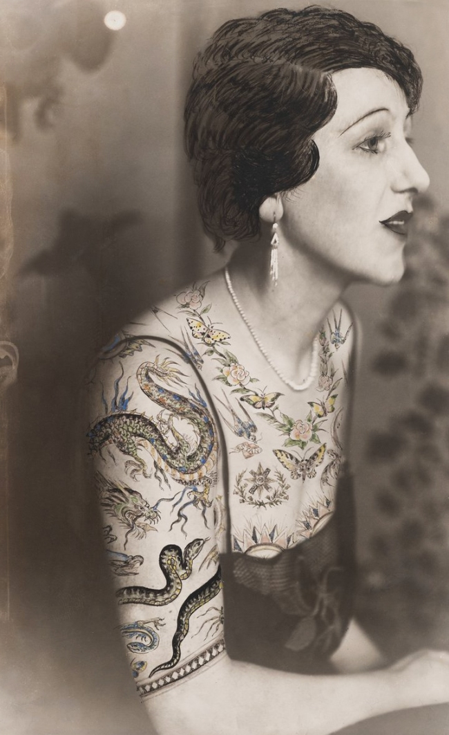 Dora Maar (French, 1907-1997) 'Woman sitting in profile, the bust dressed in a blouse made of tattoo patterns drawn on the photograph' c. 1930