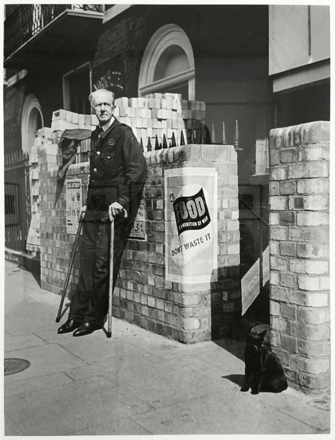Robert Capa (American-Hungarian, 1913-1954) 'Man and cat outside an air-raid shelter, London, UK' June-July 1941