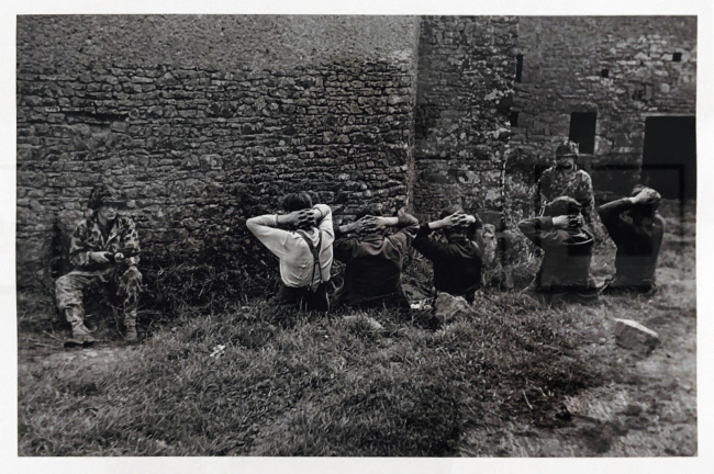 Robert Capa (American-Hungarian, 1913-1954) 'American soldiers guard a group of captured Germans, southwest of Saint-Lð, Normandy, France' July 26-30, 1944