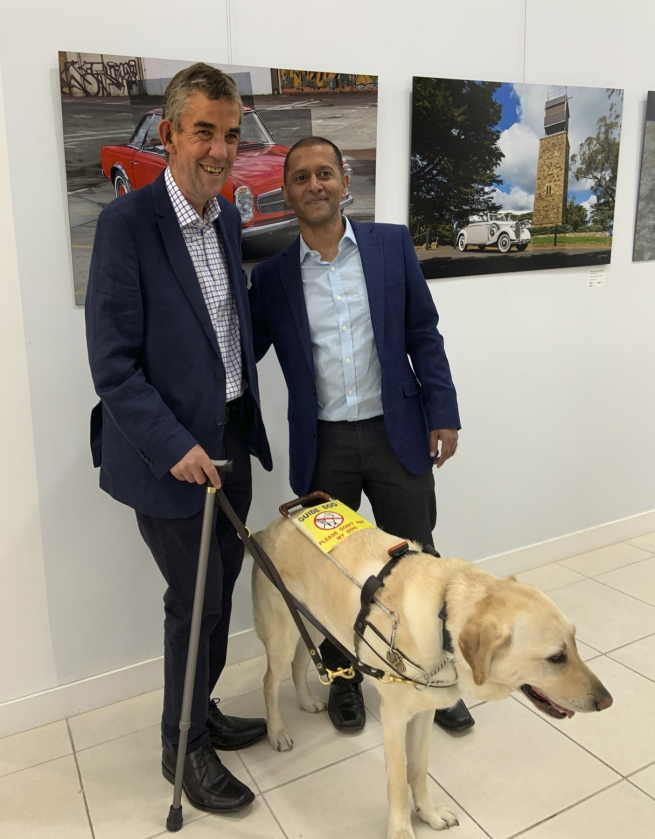Andrew Follows with his guide dog Leo and his mentor Dishan Marikar