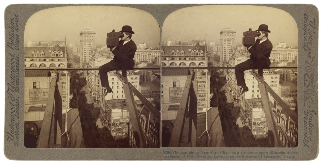Underwood & Underwood (American, 1881-1940s) 'Photographing New York City - on a slender support 18 stories above pavement of Fifth Avenue' 1905