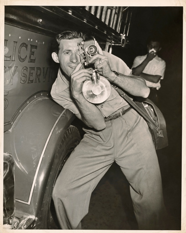 Weegee (Arthur Fellig) (American, born Austria, 1899-1968) 'Photographer at a Fire' 1940-1945