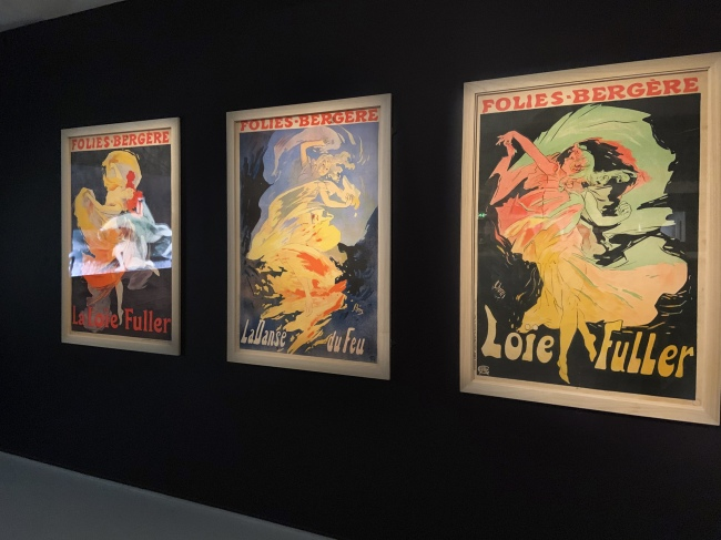Installation view showing Jules Cheret Folies Bergere La Loie Fuller lithographs