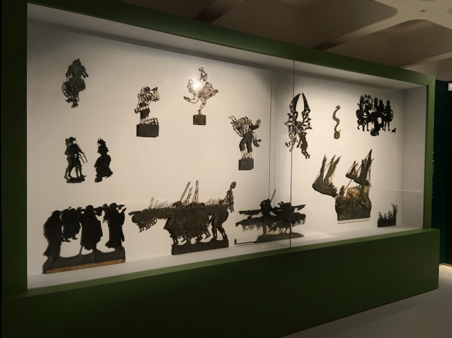 Installation view of the exhibition Into the Night: Cabarets and Clubs in Modern Art at the Barbican Art Gallery, London showing Henri Rivière and Henry Somm's shadow theatre