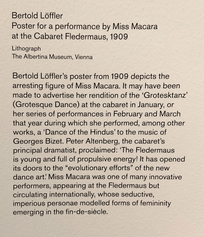 Wall text about the poster for a performance by Miss Macara