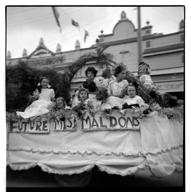 Unknown photographer (Australian) 'Untitled (Future Miss Maldons, Maldon Show, Maldon, Victoria, with Maldon Timber & Hardware at 28 Main Street in the background)' 1946-47