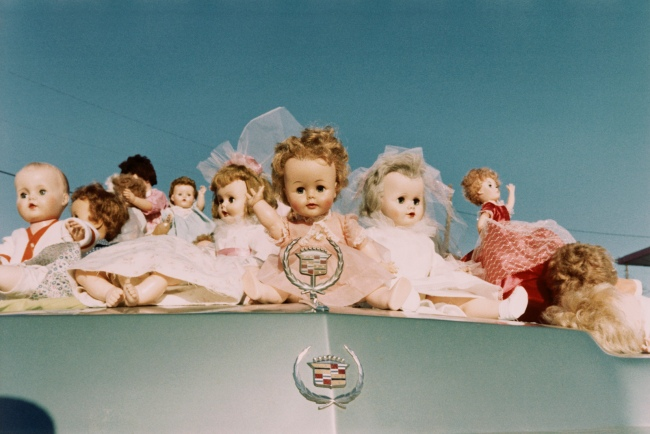 William Eggleston (American, b. 1939) 'Dolls on Cadillac, Memphis' 1972