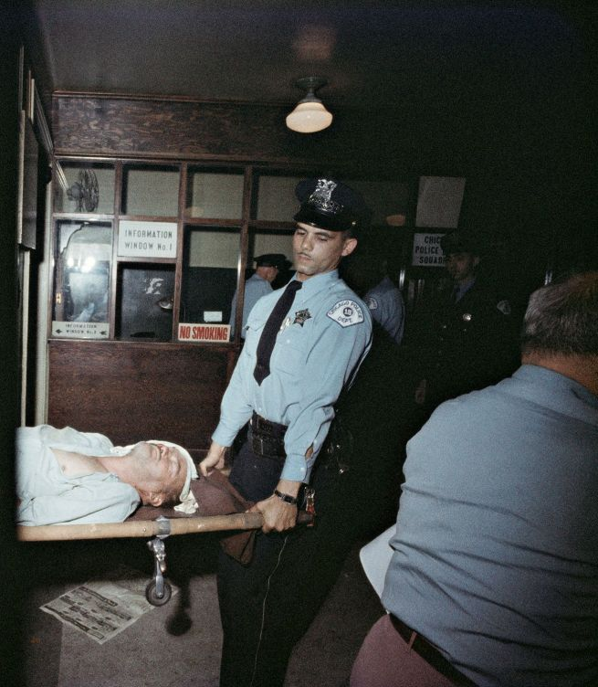 Gordon Parks (American, 1912-2006) 'Police Bring in Victim, Chicago, Illinois' 1957