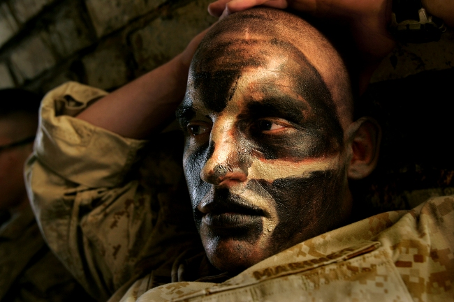 Carolyn Cole (American, b. 1961) 'A US marine is covered in camouflage face paint during the battle for Najaf, Iraq' August 2004