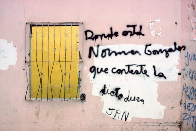 "Susan Meiselas (American, b. 1948) 'Wall graffiti on Somoza supporter's burned house in Monimbó, asking ""Where is Norman Gonzales? The dictatorship must answer"", Nicaragua' 1978"