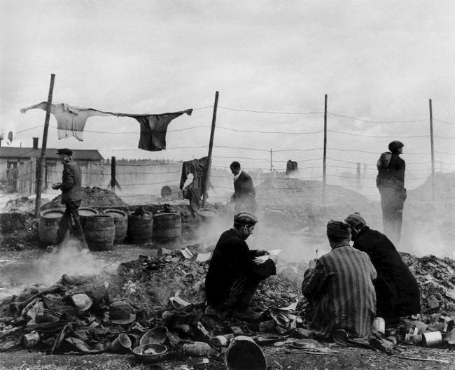 Lee Miller (American, 1907-1977) 'Freed prisoners scavenging in the rubbish dump, Dachau' Germany, 1945