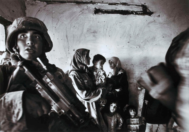Anja Niedringhaus (German, 1965-2014) 'Baghdad, Iraq. US Marines raid the house of an Iraqi delegate in the Abu Ghraib district' November 2004