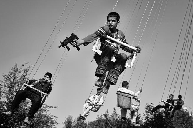 Anja Niedringhaus (German, 1965-2014) 'An Afghan boy holds a toy gun' September 2009