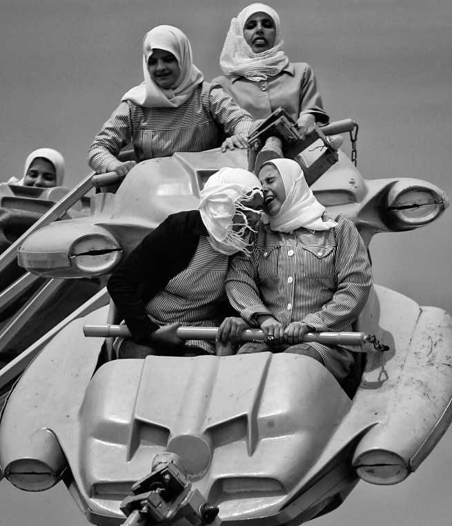 Anja Niedringhaus (German, 1965-2014) 'Palestinians enjoy a ride at an amusement park outside Gaza City, Gaza City, Gaza Strip' March 2006
