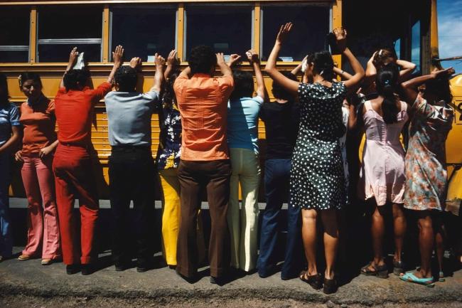 Susan Meiselas (American, b. 1948) 'Soldiers search bus passengers along the Northern Highway, El Salvador' 1980