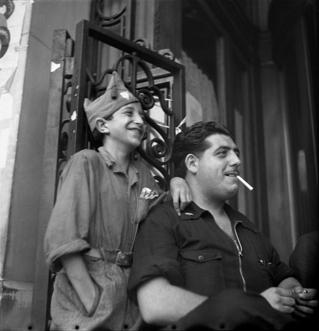 Gerda Taro (German, 1910-1937) 'Man with child in militia dress, Barcelona, Spain' August 1936