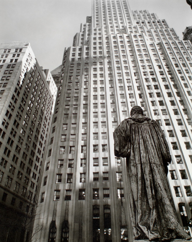 Berenice Abbott (American, 1898-1991) 'John Watts statue, from Trinity Churchyard looking toward One Wall Street, Manhattan' March 1, 1938