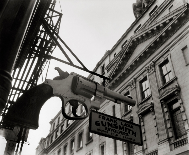 Berenice Abbott (American, 1898-1991) 'Gunsmith and Police Department, 6 Centre Market Place, Manhattan'  February 4, 1937