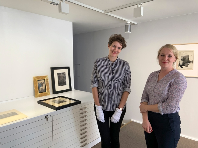 Tamara Könen of the gallery (left) and Kristina Engels from August Sander Stiftung – at Galerie Julian Sander, standing in front of August Sander's photographs