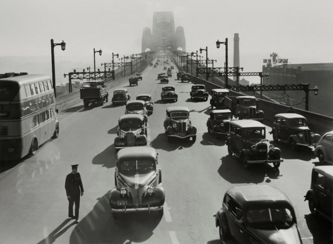 Max Dupain (Harbour Bridge with Traffic, Buses and Policeman) 1940-50s