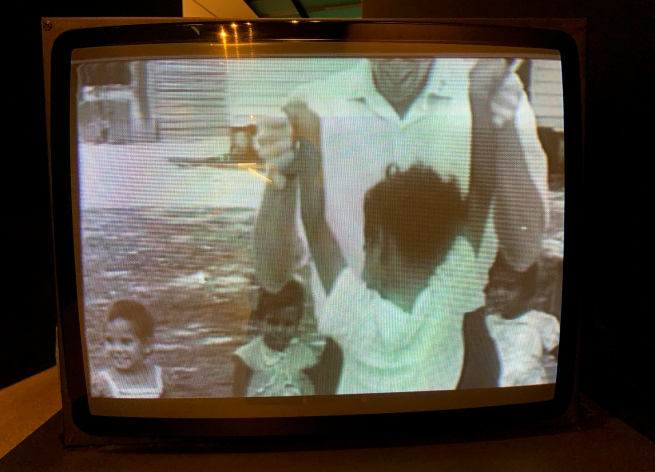 Destiny Deacon (Kuku/Erub/Mer b. Australia 1957) Virginia Fraser (Australian) 'Abi see da classroom' 2006 (still)