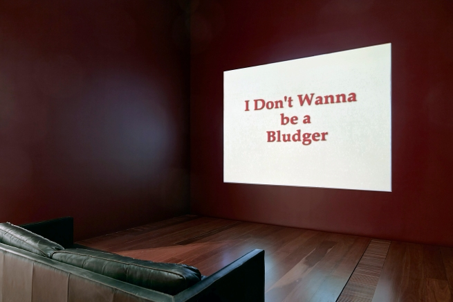 Installation view of Destiny Deacon and Michael Riley's 'I don't wanna be a bludger' 1999