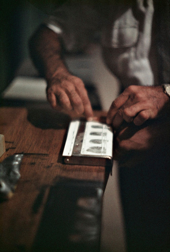 Gordon Parks (American, 1912-2006) 'Fingerprinting Addicts for Forging Prescription, Chicago, Illinois' 1957