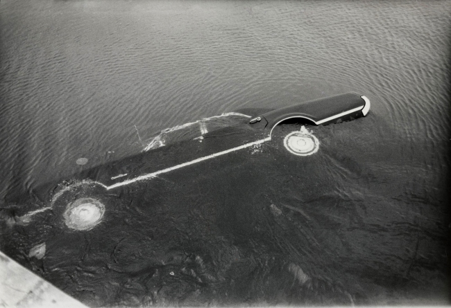"John Hubbard / Black Star Publishing Company. ""Kennedy Car off Bridge to Chappaquiddick Island, Massachusetts"" July 19, 1969"