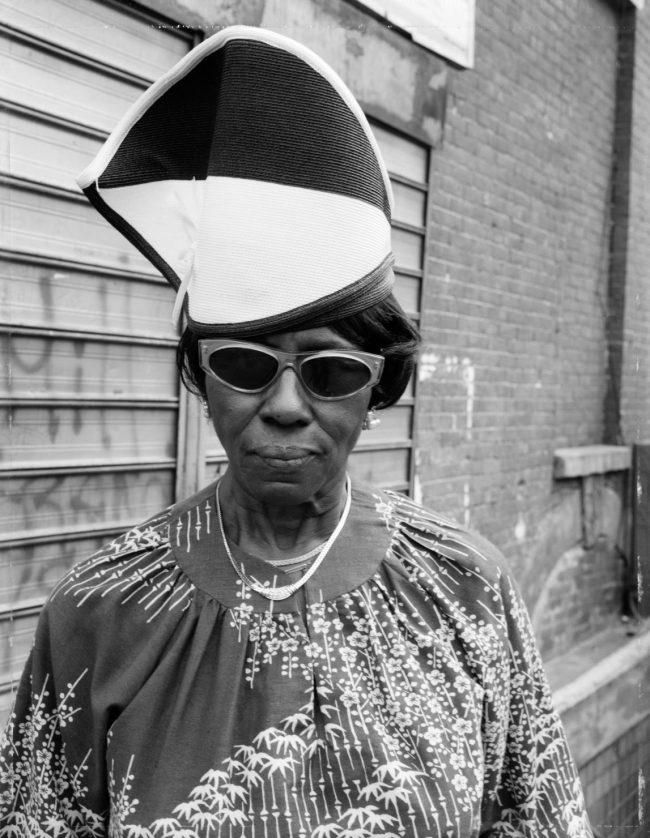 Dawoud Bey (American, b. 1953) 'A Woman at Fulton Street and Washington Avenue, Brooklyn, NY, 1988' 1988