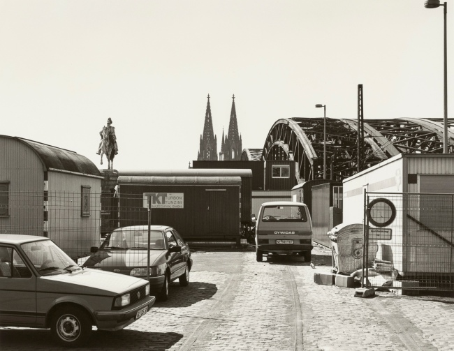 Wilhelm Schürmann (German, b. 1946) 'Untitled (construction trailer and view of Cologne Cathedral)' 1988