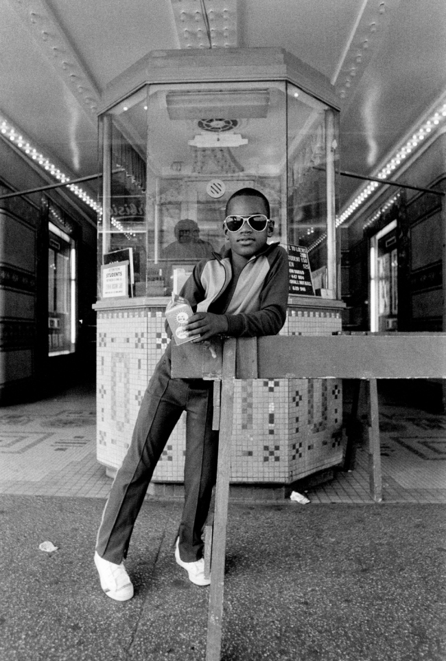 Dawoud Bey (American, b. 1953) 'A Boy in Front of the Loew's 125th Street Movie Theater, Harlem, NY, 1976' 1976