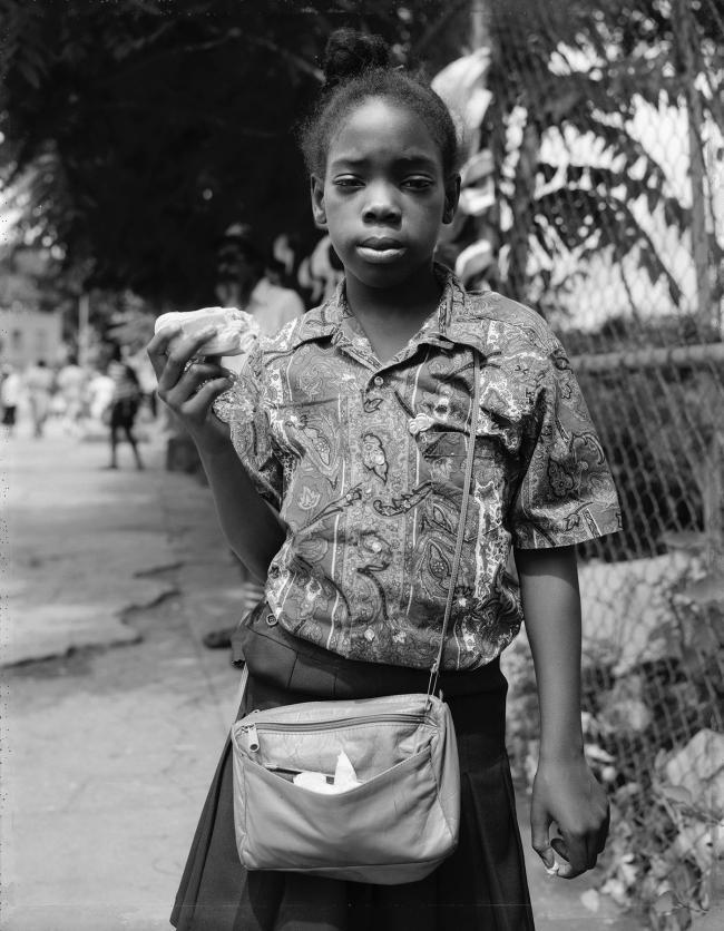 Dawoud Bey (American, b. 1953) 'A Girl Holding a Hotdog and Gum, Brooklyn, NY, 1989' 1989