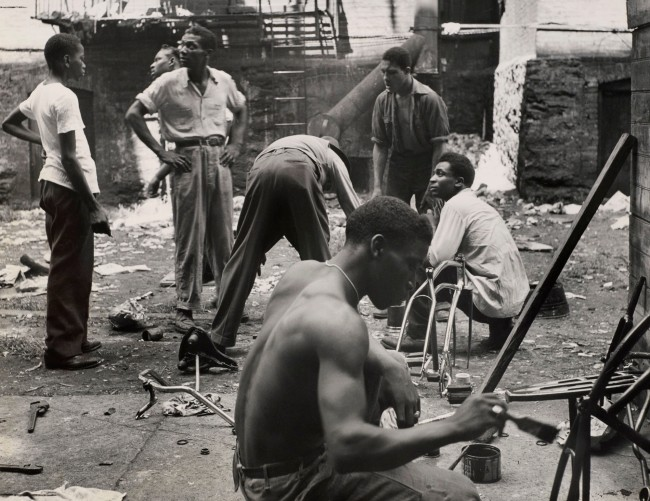 "Gordon Parks (1912-2006) 'Leonard ""Red"" Jackson (standing, right) supervises painting of bicycles belonging to members of his Harlem gang. In foreground is ""Brother"" Price, Red's cousin and assistant gang leader 1948' Oct. 8, 1948"