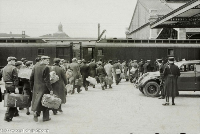 Harry Croner (German, 1903-1992) 'Untitled [Men boarding a train at Austerlitz station for the Loiret camps]' May 14, 1941