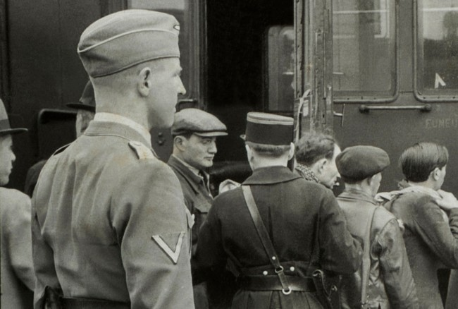 Harry Croner (German, 1903-1992) 'Untitled [Theodor Dannecker oversees the transfer of the rounded up Jews to the Austerlitz station]' May 14, 1941 (detail)