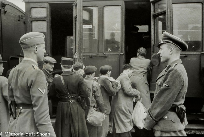 Harry Croner (German, 1903-1992) 'Untitled [Theodor Dannecker oversees the transfer of the rounded up Jews to the Austerlitz station]' May 14, 1941