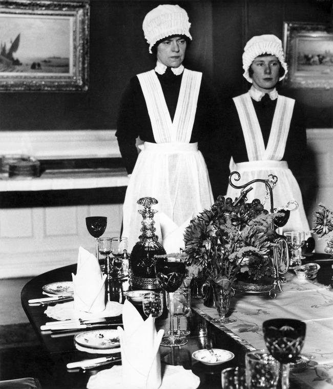 Bill Brandt (British, born Germany 1904-1983) 'Parlourmaid and Under-parlourmaid ready to serve dinner' 1936