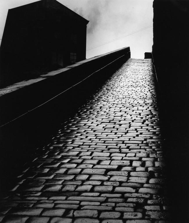 Bill Brandt (British, born Germany 1904-1983) 'A snicket in Halifax' 1937