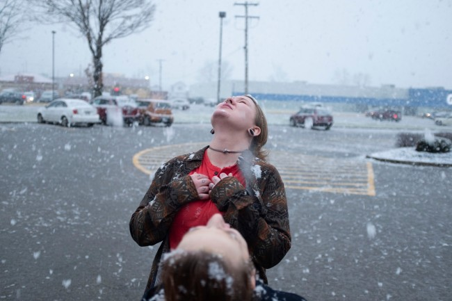 Mark E. Trent (American) 'Allie and Regina catching snowflakes after a close friend's funeral' Nd