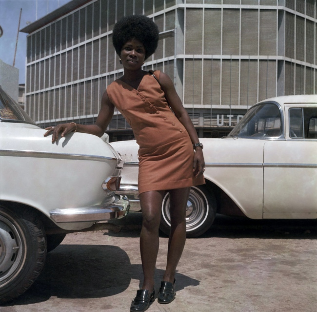 James Barnor (Ghanian, b. 1929) 'A store assistant on Station Road, Accra' 1971