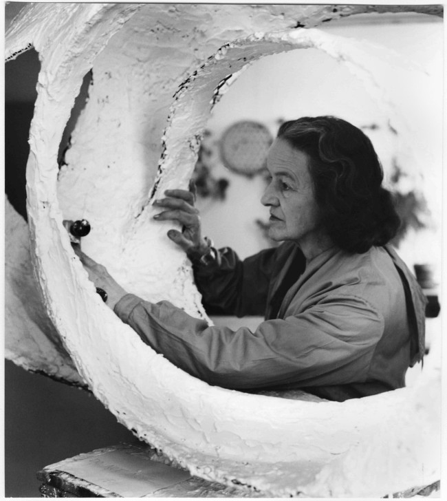 Barbara Hepworth at work on the plaster for 'Oval Form (Trezion)' 1963