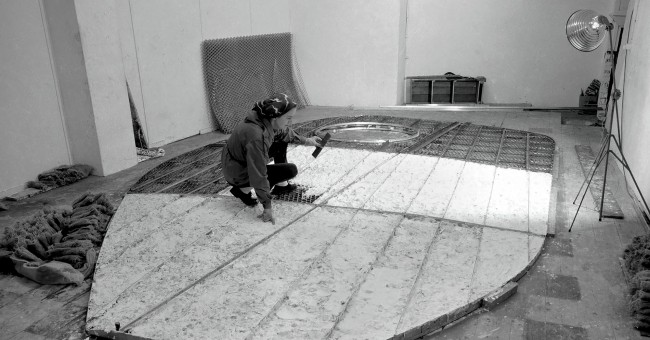 Barbara Hepworth working on the armature of 'Single Form' in the Palais de Danse, St Ives 1961