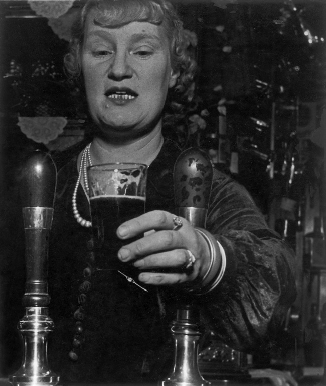 Bill Brandt (British, born Germany 1904-1983) 'Barmaid at the Crooked Billet, Tower Hill' March 1939