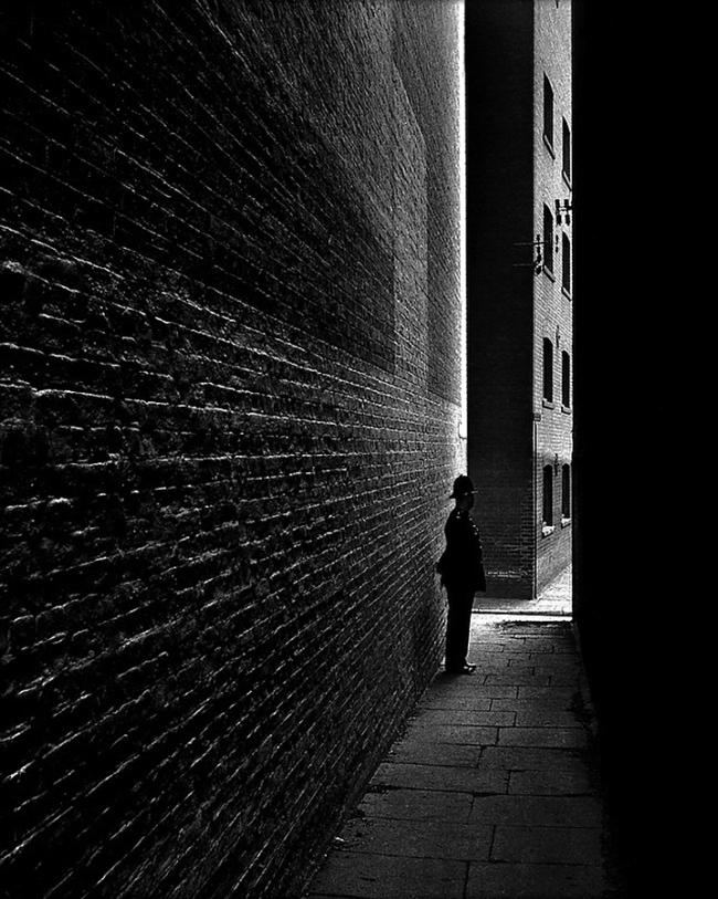 Bill Brandt (British, born Germany 1904-1983) 'Policeman in a Dockland Alley, Bermondsey' 1934