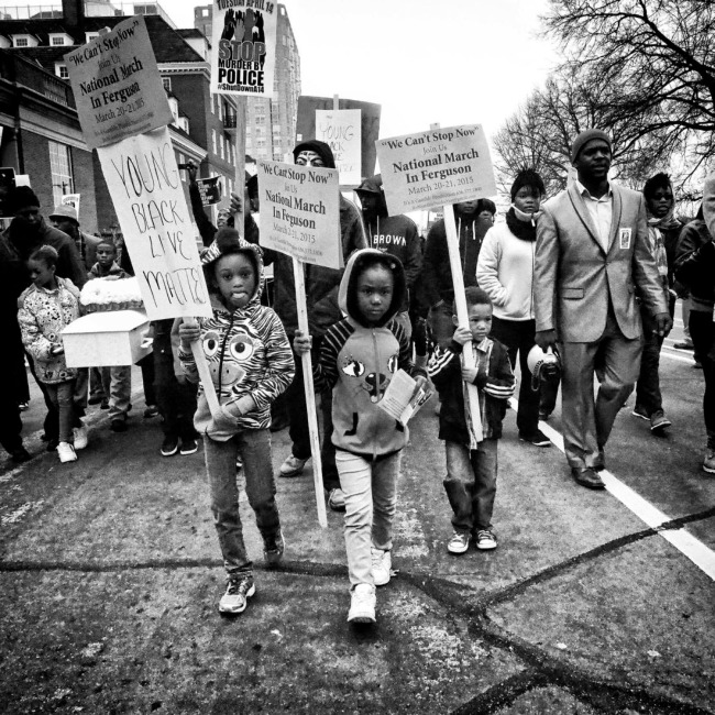"""Sheila Pree Bright (American, b. 1967) '#1960Now Ferguson protest: National March in Ferguson, """"We Can't Stop"""" Mike Brown, Ferguson, MO, March 2015' 2015"""