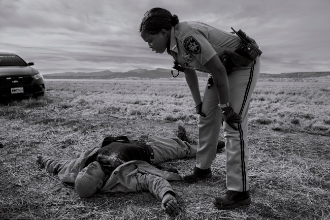 James Nachtwey (American, b. 1943) 'Dorothy Onikute, 33, a deputy sheriff with the Rio Arriba County sheriff's office, responding to an overdose call on Feb. 4, on the side of the road in Alcalde, N.M.' Nd