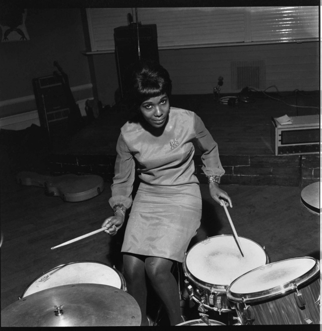 James Barnor (Ghanian, b. 1929) 'Model playing drums: Constance Mulondo, 'Drum' cover, at London University Weekend with the band The Millionaires, London' 1967