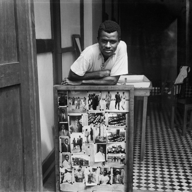 James Barnor (Ghanian, b. 1929) 'Portrait of James Barnor in front of some of his photographs, Accra' 1957