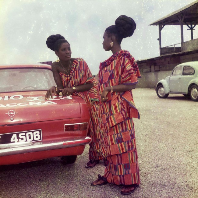 James Barnor (Ghanian, b. 1929) 'Two friends dressed for a church celebration with James' car, Accra' 1970